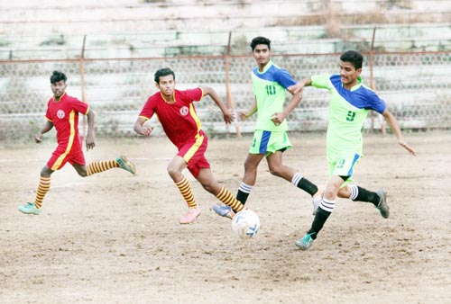 Footballers in action during a match of 63rd National School Games at MA Stadium in Jammu. -Excelsior/ Rakesh