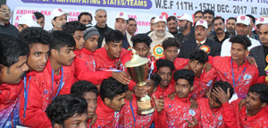 Champions Kerala posing along with Minister for Sports, Moulvi Imran Raza Ansari and other dignitaries in Jammu on Friday.