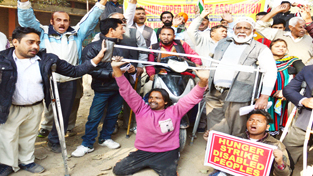 Differently abled people protesting near Press Club, Jammu on Sunday. — Excelsior/Rakesh