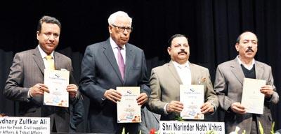 Governor N N Vohra and Ministers releasing 'Towards Digital Revolution' publication of FCS&CA Deptt at Gen Zorawar Singh Auditorium, Jammu.