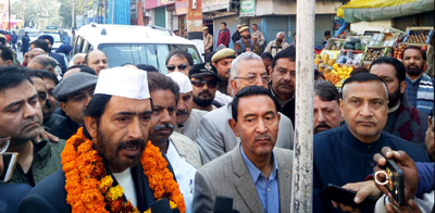 PCC president G A Mir and other leaders moving to party office to attend Cong Foundation Day function in Jammu.