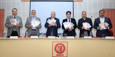 Former DGP Kuldeep Khoda and others launching books at MIER on Tuesday.