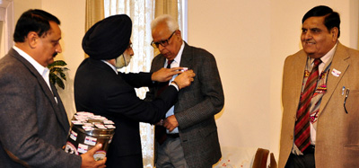 Governor NN Vohra being pinned flag on Armed Forces Flag Day at Jammu on Thursday.