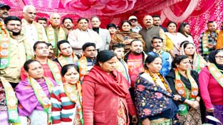 BJP leaders with new entrants in party on Sunday.