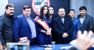Office bearers of Chamber of Commerce and Industries and others posing with Mrs India Universe, Anisha Safaya during a function at Jammu.