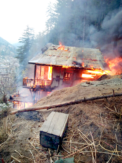A residential house in flames at Chatroo in Kishtwar.