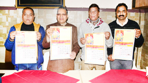 Pawan Kumar Shastri, president, JYBT along with other Trustees releasing New Year 'Panchang'.