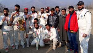 Winners of Shaheed Moomin Cup Cricket Tournament posing for a group photograph in Srinagar.