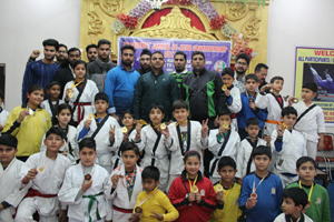 Winners of Jijitsu Championship posing along with chief guest and other dignitaries in Jammu.
