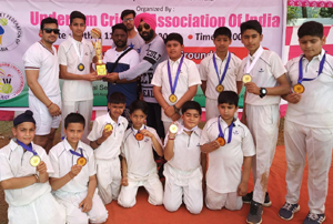 Players of J&K Underarm Cricket team posing for a group photograph after emerging runners-up at Goa.