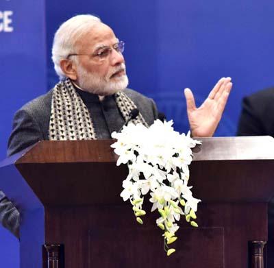 Prime Minister Narendra Modi addressing the First PIO Parliamentarian Conference, in New Delhi on Tuesday. (UNI)