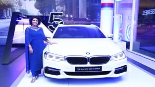 Vasanthi Bhupati, Dealer Principal, KUN Exclusive showing a BMW car during opening ceremony.