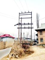 Malangpora village in Pulwama waits for transformer damaged a week ago. -Excelsior/Younis Khaliq