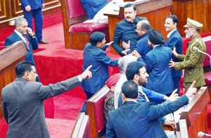 NC member Sajjad Ahmed Kichloo being marshalled out of Legislative Council on Monday. — Excelsior/Rakesh