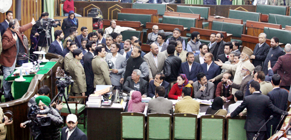 Opposition MLAs protesting in the Well of House as Speaker Kavinder Gupta is seen trying to persuade them on Wednesday. —Excelsior/Rakesh