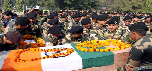 Coffin carrying body of martyr BSF jawan being shifted to his residence with full military honours in Jammu on Thursday. -Excelsior/Rakesh