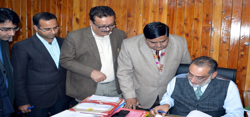 Finance Minister Dr Haseeb Drabu giving final touch to the budget speech 2018-19 in Jammu on Wednesday.