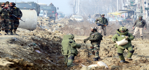 Members of the Bomb Disposal Squad trying to defuse an IED in Srinagar on Saturday. (UNI)