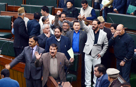 Opposition MLAs protesting in the Assembly on Saturday. -Excelsior/Rakesh