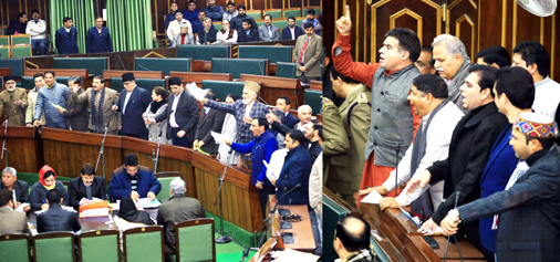 Opposition members (left) and ruling BJP MLAs (right) protesting in the Assembly on Tuesday. -Excelsior/Rakesh