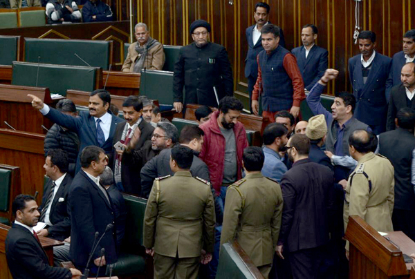 NC and Congress MLAs protesting in Well of the House after Speaker alleged breach of his own privileges. —Excelsior/Rakesh