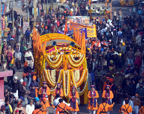 Impressive 'Nagar Kirtan' being taken out in Jammu to mark Gurpurab celebrations in Jammu on Tuesday. - Excelsior/ Rakesh