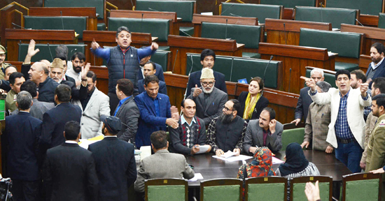 Opposition MLAs protesting in Well of the House seeking suspension of police officers for minor girl's death case. -Excelsior/Rakesh