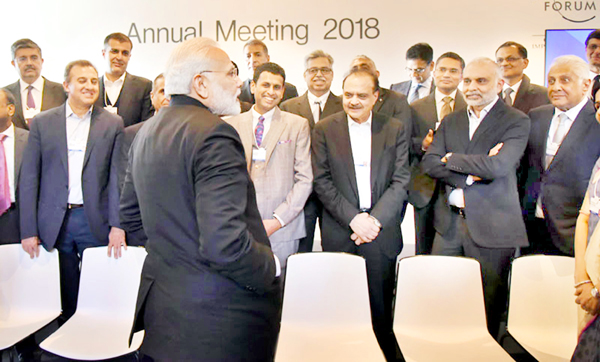 Prime Minister Narendra Modi interacting with Indian CEOs in Davos on Tuesday (UNI)