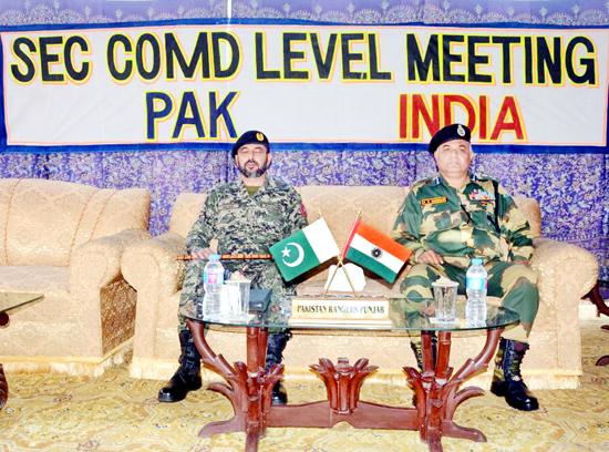 P S Dhiman, DIG BSF Jammu Sector, meeting Brig Amjad Hussain, Sector Commander Chenab Rangers, Sialkot Punjab, Pakistan in Suchetgarh on Thursday.