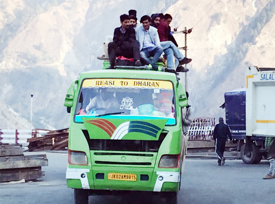 An overloaded minibus on Reasi road.