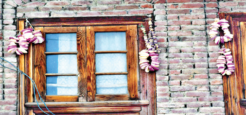Dried vegetables hang on the wall of a house in Srinagar. -Excelsior/Shakeel