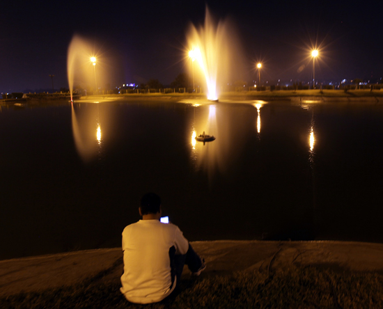 A tourist enjoying an evening at Bagh-e-Bahu in Jammu. -Excelsior/Rakesh