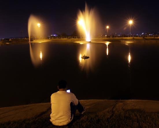 A tourist enjoying an evening at Bagh-e-Bahu in Jammu. -Excelsior/Rakesh