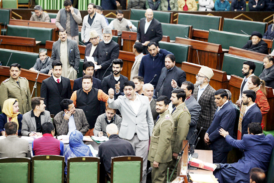 Opposition MLAs protesting in the Assembly before staging walk-out on power crisis in Kashmir on Friday. -Excelsior/Rakesh