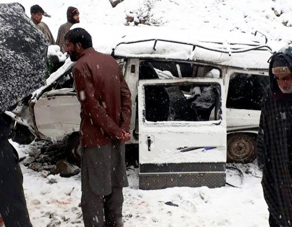 A van which slipped into gorge at Kapran, Anantnag on Tuesday. -Excelsior/Sajad Dar