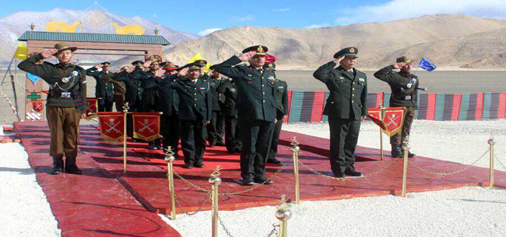 India and China soldiers saluting the national flag of India during ceremonial Border Personnel Meeting (BPM) at Chushul area in Ladakh sector. (UNI)