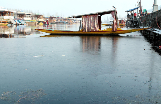 The water of world famous Dal lake was frozen on Sunday. (UNI)