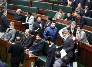 Omar Abdullah-led NC members staging walk-out in the Assembly on Monday. — Excelsior/Rakesh
