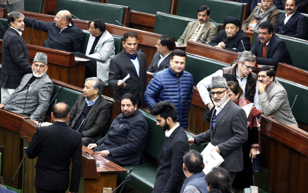 Omar Abdullah-led NC members staging walk-out in the Assembly on Monday. -Excelsior/Rakesh