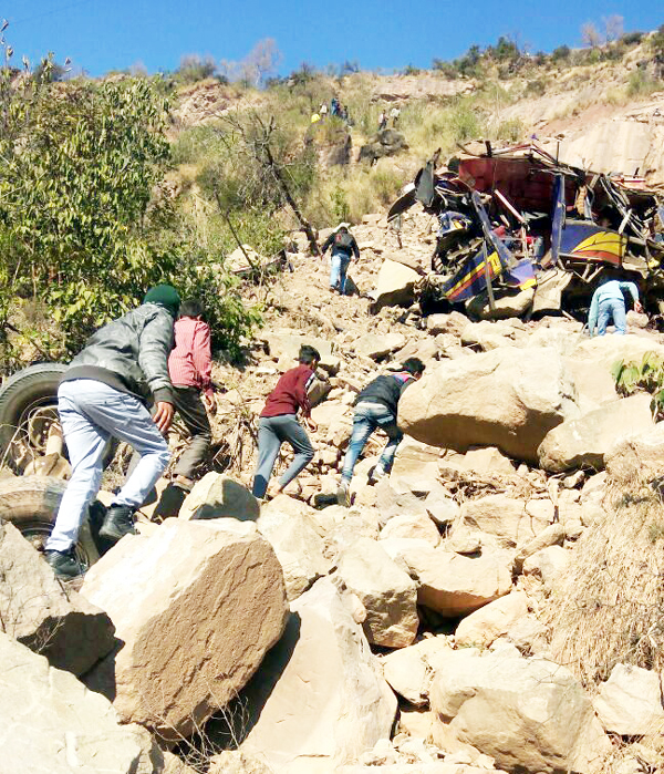 Locals and police conducting rescue operation at site of accident on Saturday.