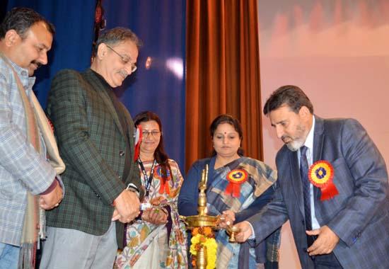 Minister for Education, Altaf Bukhari and his dignitaries lighting ceremonial lamp at GGHS Gandhi Nagar in Jammu.
