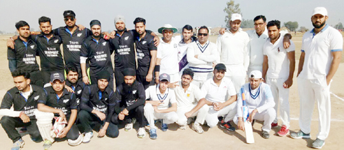 Players of Sher-e-Kashmir CC posing for a photograph after registering victory.