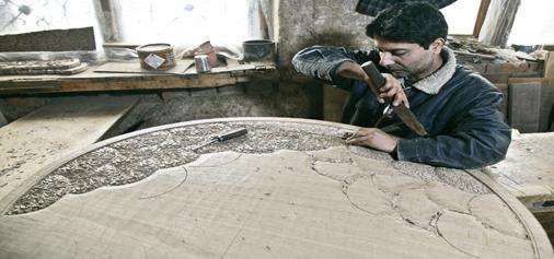 A Kashmiri wood carver works on a piece of wood in Srinagar. —Excelsior/Shakeel
