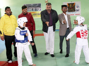 Dignitaries declaring open the bout while inaugurating State Taekwondo Championship at MA Stadium in Jammu.