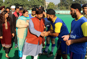 Minister for Forests, Ch Lal Singh interacting with Hockey players at KK Hakhu Astroturf Stadium in Jammu on Tuesday.