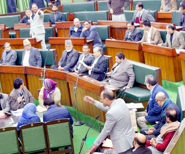 Minister for Rural Development Abdul Haq Khan and Congress MLA trading charges in Legislative Assembly on Tuesday. -Excelsior/Rakesh