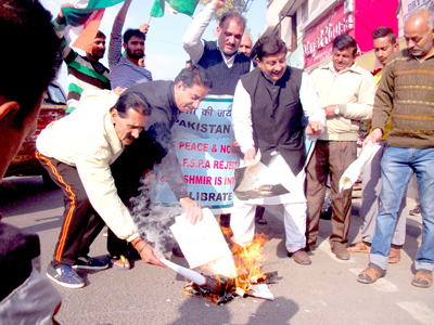 Activists of Jammu West Assembly Movement torching copies of Governor's address on Friday.