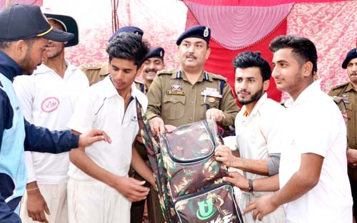 IGP Jammu, Dr SD Singh Jamwal presenting kits to budding sportspersons in Udhampur.