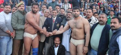 Dignitaries declaring winner of 118th Panthal Kesari title at Katra.