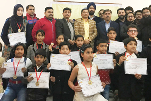Winners of State Chess Championship posing along with chief guest and other dignitaries in Jammu.